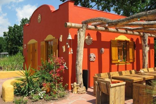 Bon A Mexican Inspired Garden. Brightly Coloured Render With Textural Foliage.
