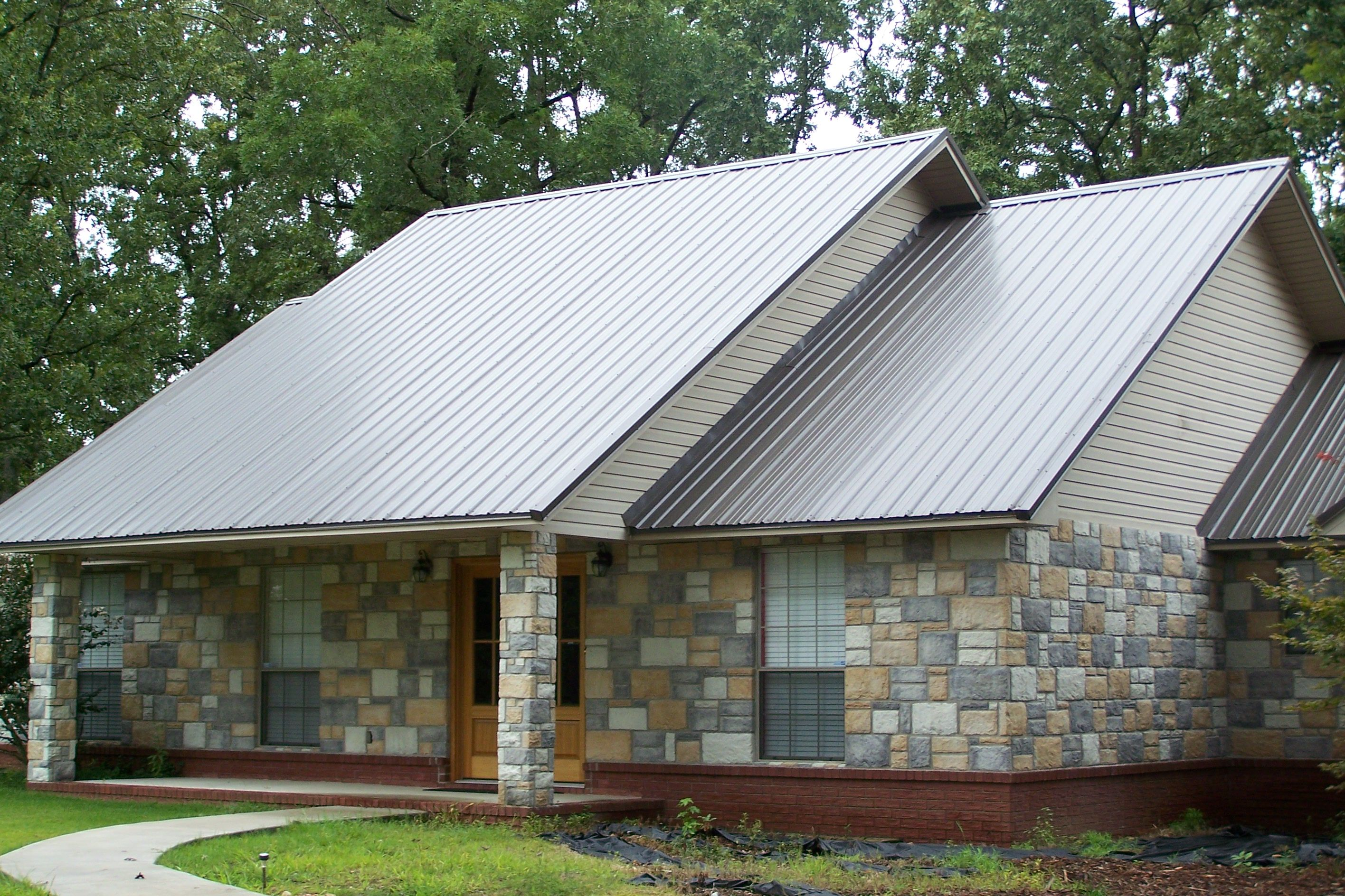 Beautiful house plans with metal roofs metal roofing for Images of houses with metal roofs