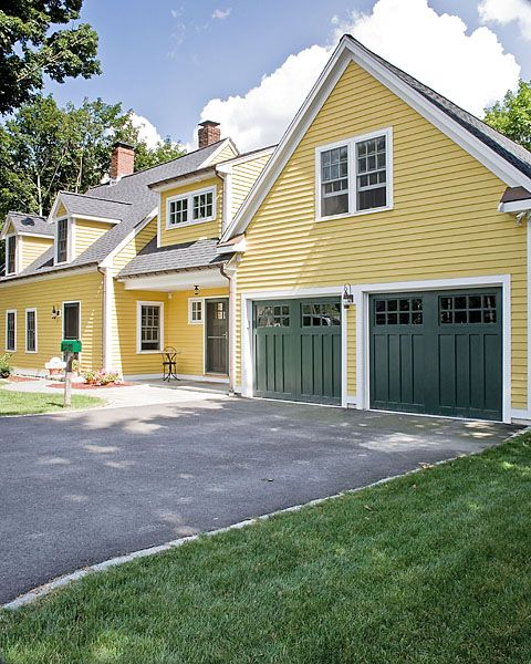 Pretty Yellow House With Dark Green Carriage Style Doors And An Onion Lantern