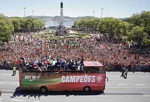 Portugal's victorious team ride in an open-top bus on their return to Lisbon.