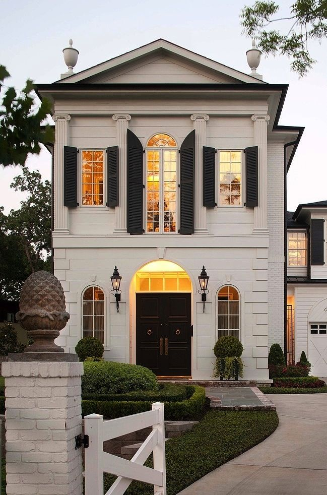 Awesome French Home Exterior With Greek Columns And Black Shutters. Black Front  Entrance Door With Arched Windows And Iron Lanterns Flanking Grand Entrance.