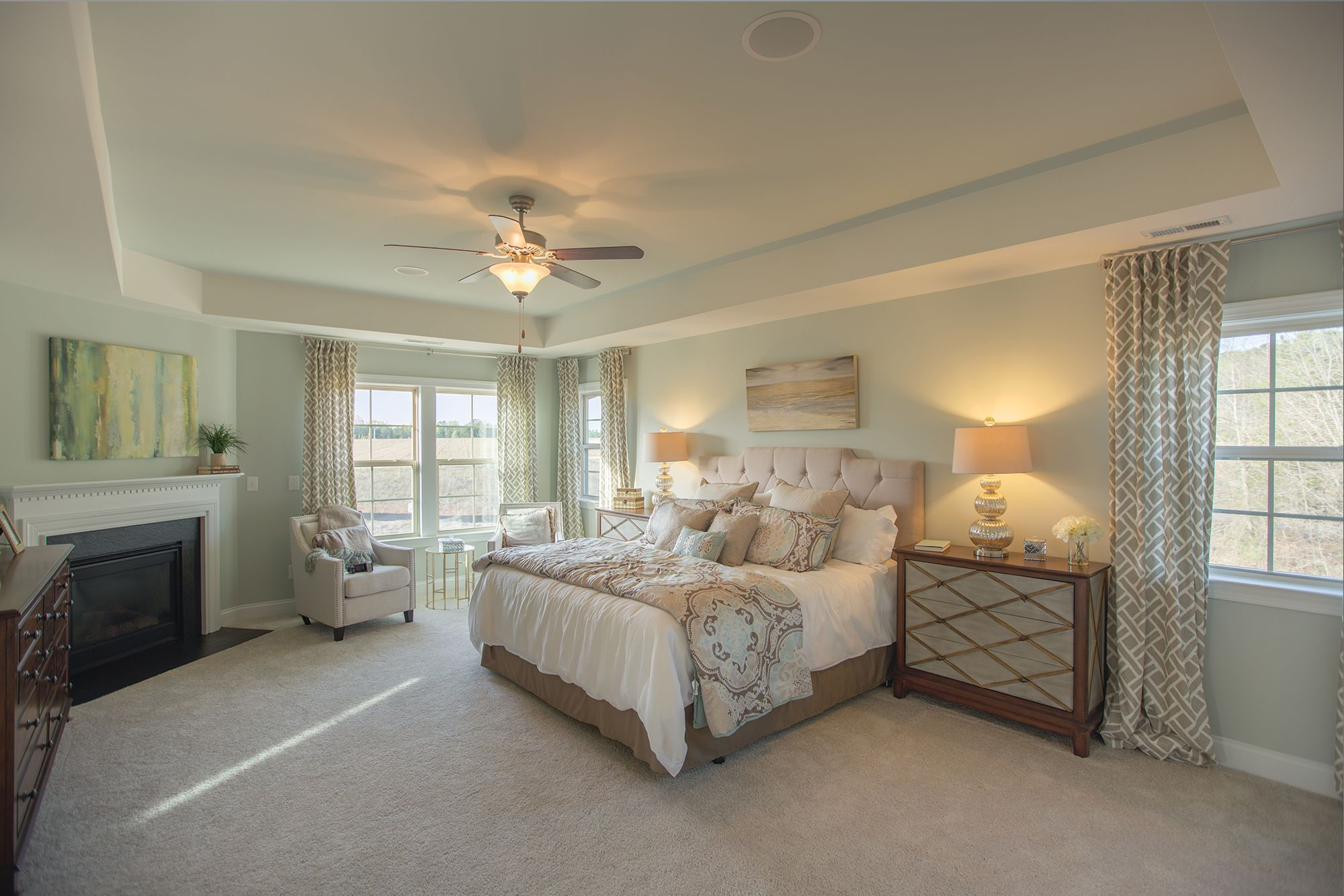 Warm lovely bedroom with lots of natural light, tufted