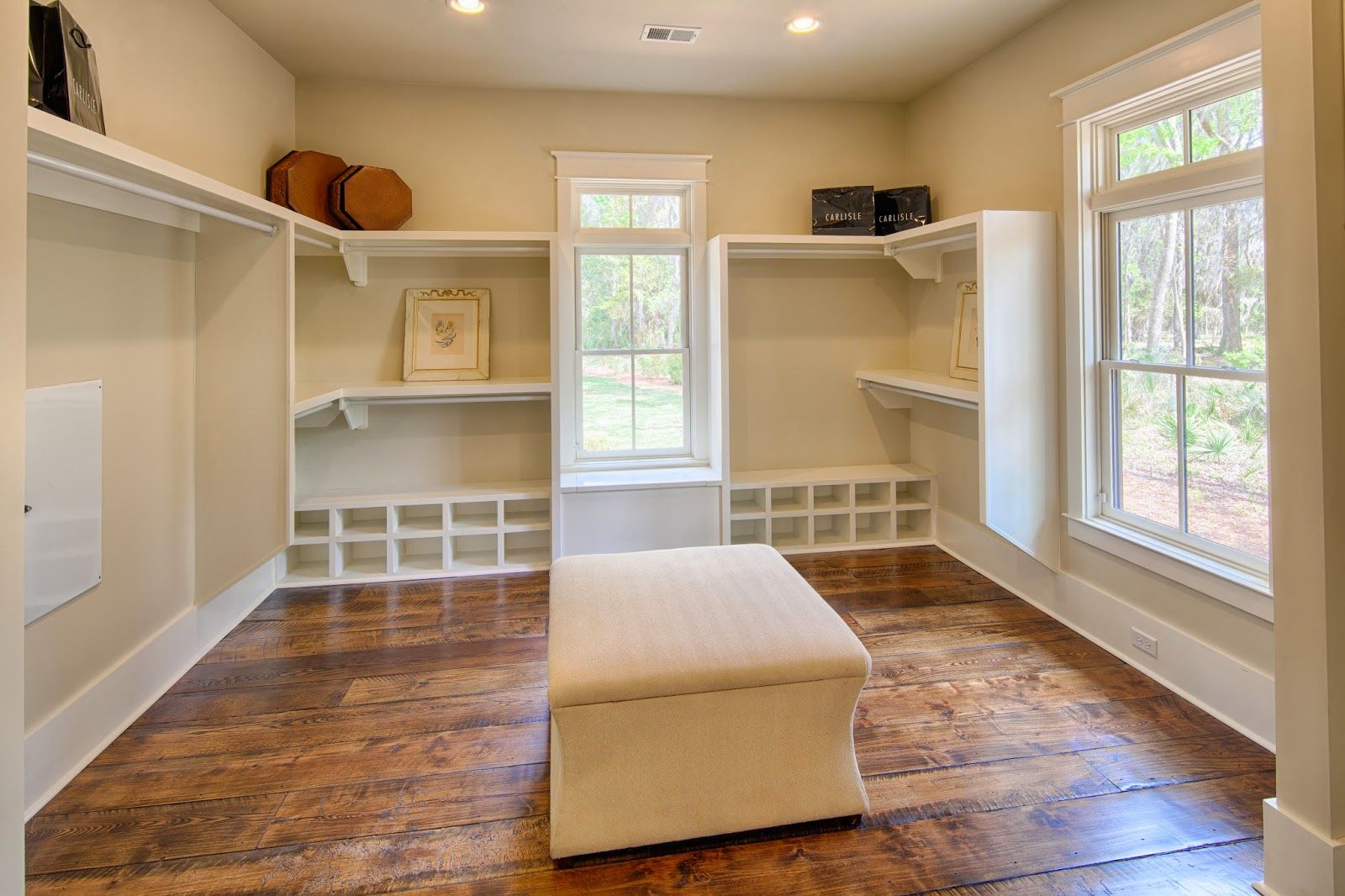 the master suite features a walk in closet with windows