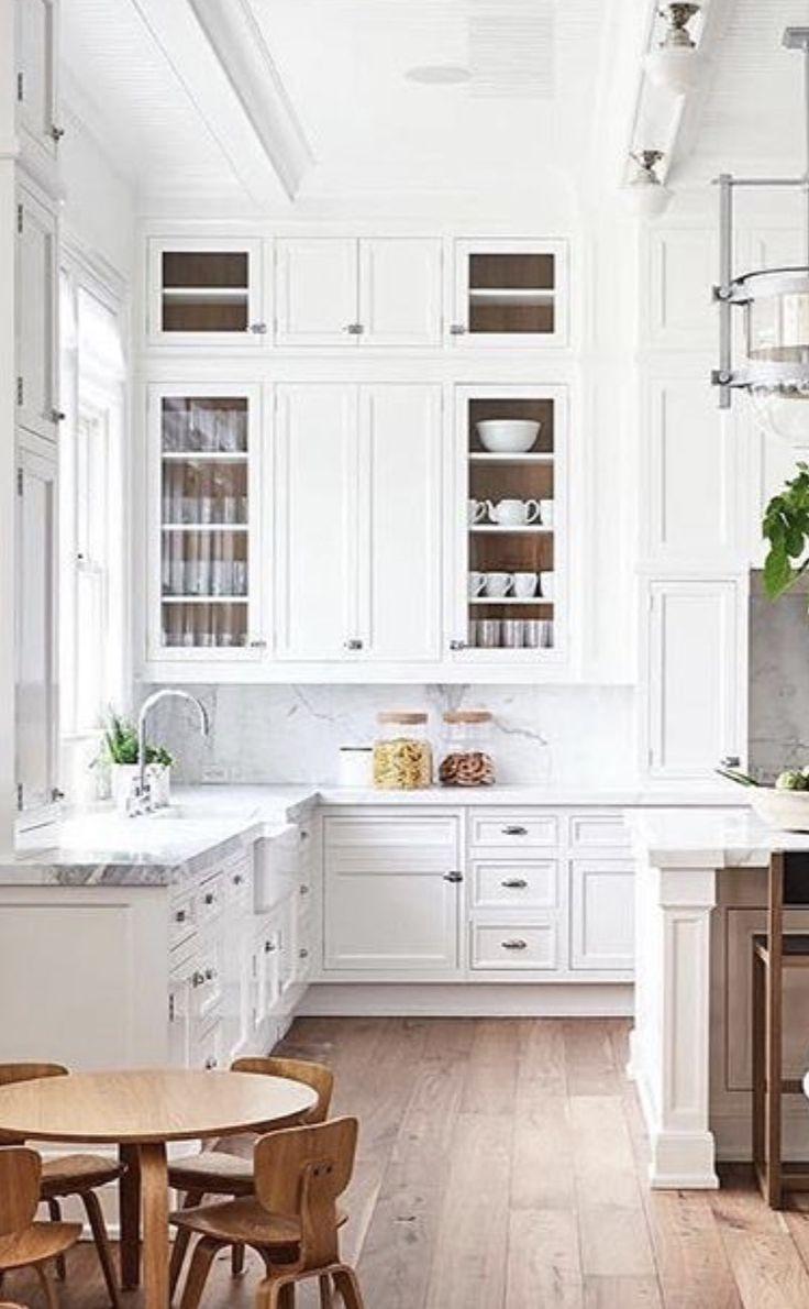 Pretty white kitchen via Elle Decor   Modern kitchen cabinet ...