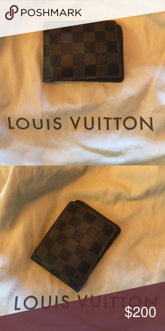 8977236d255e Men s Louis Vuitton Wallet Authentic Louis Vuitton wallet! Gently used! No  rips or tears. Duster bag NOT included. Louis Vuitton Bags Wallets