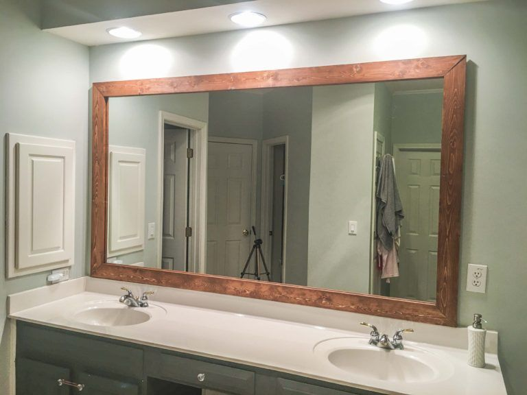 How To Diy Upgrade Your Bathroom Mirror With A Stained Wood Frame Building Our Rez Bathroom Mirrors Diy Bathroom Mirror Frame Wood Framed Bathroom Mirrors How to hang a framed bathroom mirror