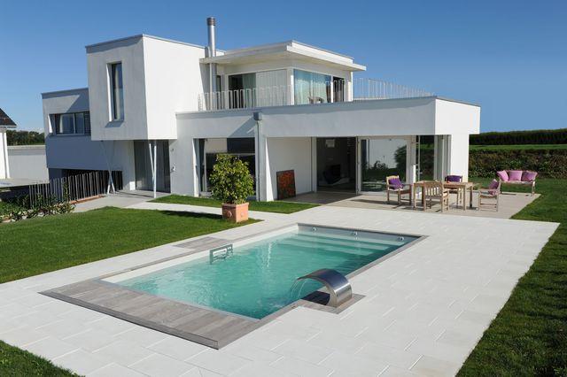 De 15 000 à plus de 50 000 euros  quel prix pour une piscine - prix d une terrasse en beton