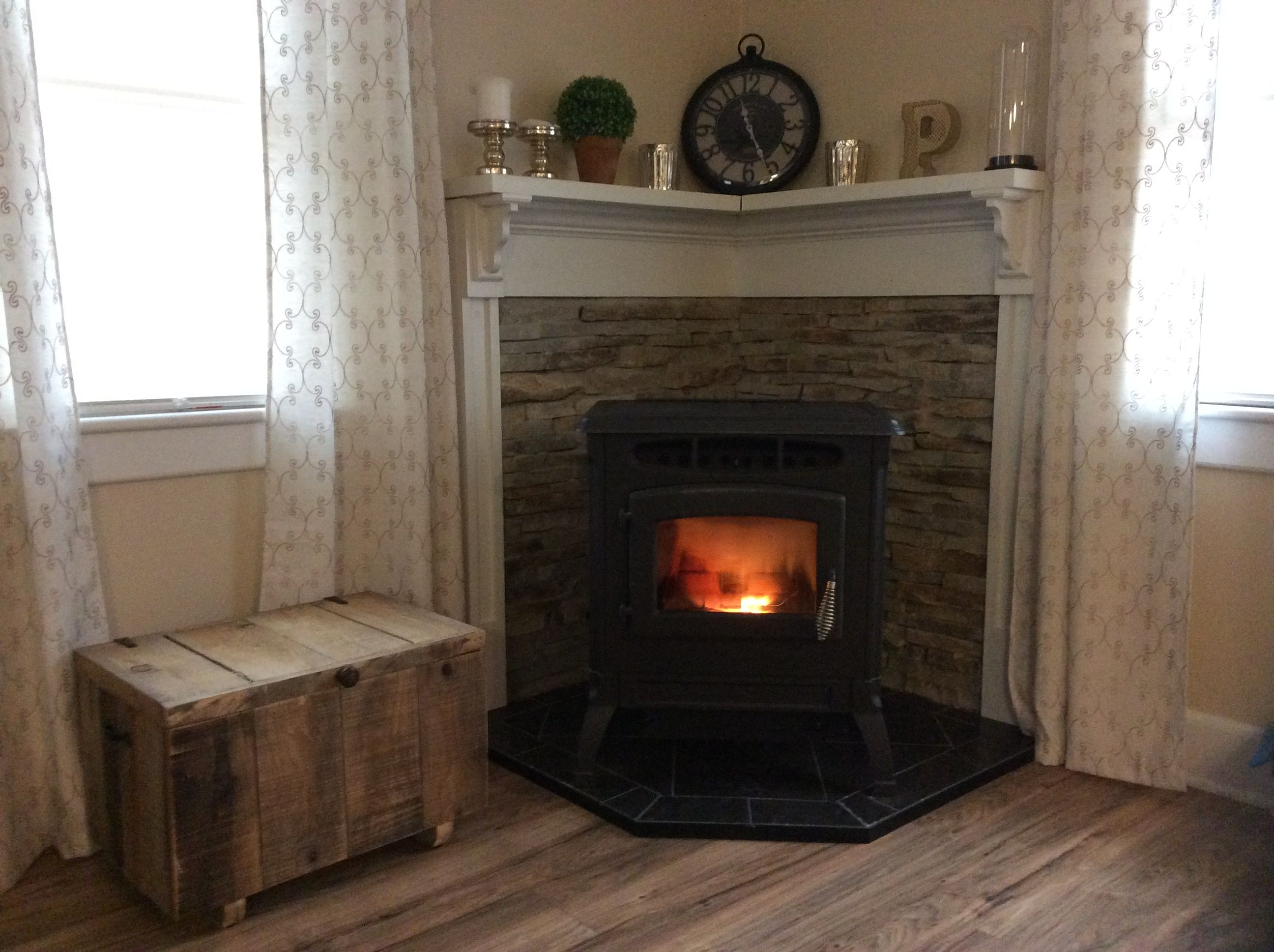Wood stove surround ideas - Pellet Stove Corner Mantle Stone Wall Rustic Pallet Box For Pellets