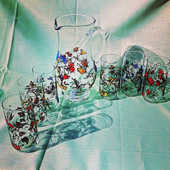 Hand painted pitcher and 6 glasses set of wild flowers red yellow blue  on Etsy, $85.99 Handpainted by Danielle Darrow from Lakewood California