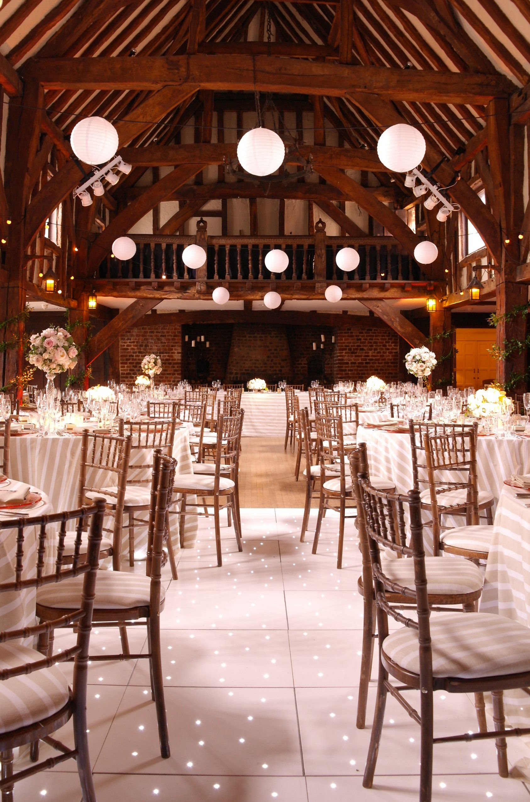 Hanging lights wedding decor  Festoons with paper lanterns at Great Fosters Hotel with starlit
