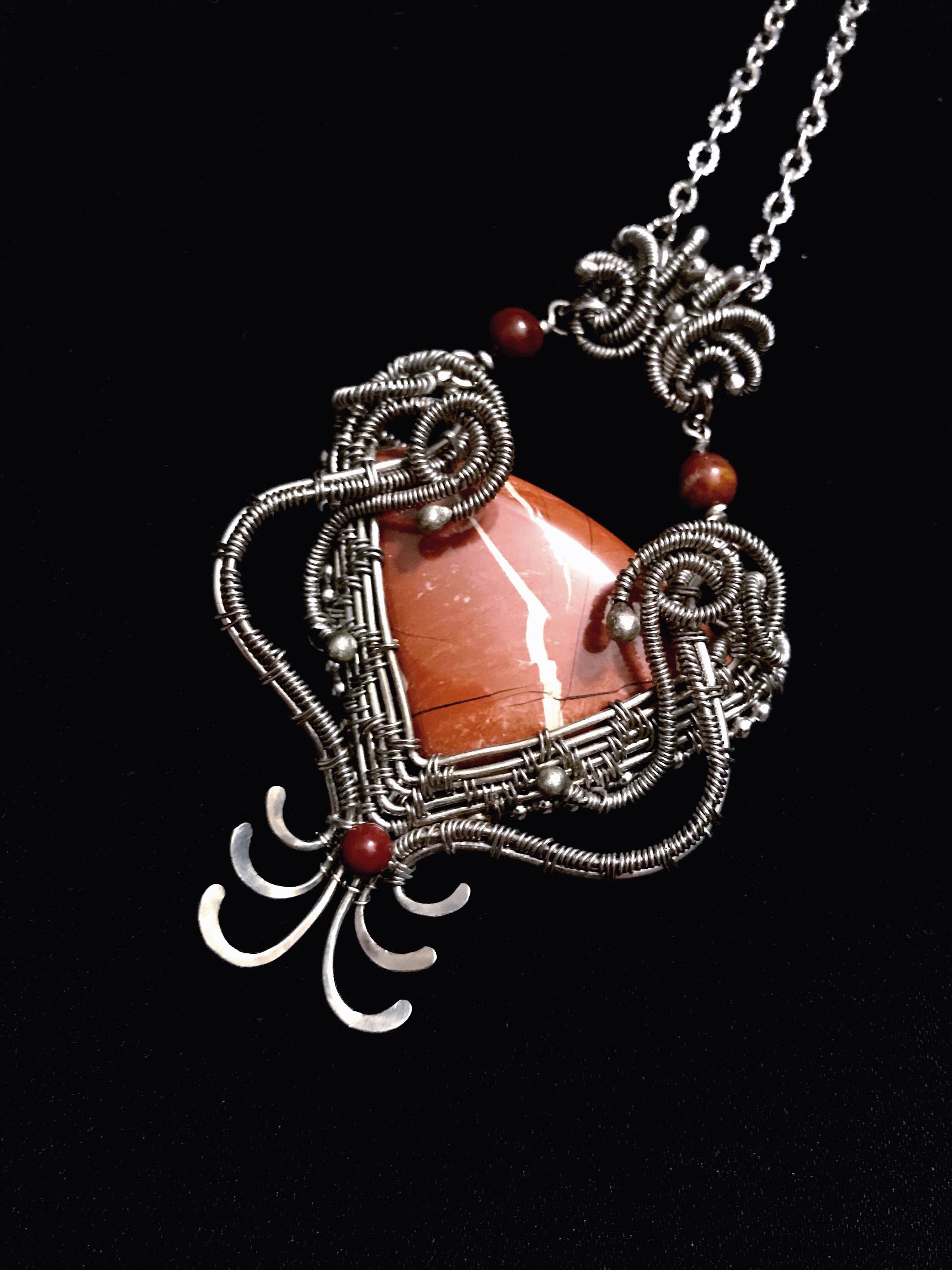 A personal favorite from my Etsy shop https://www.etsy.com/listing/487200180/art-deco-jewelry-wire-wrap-necklace