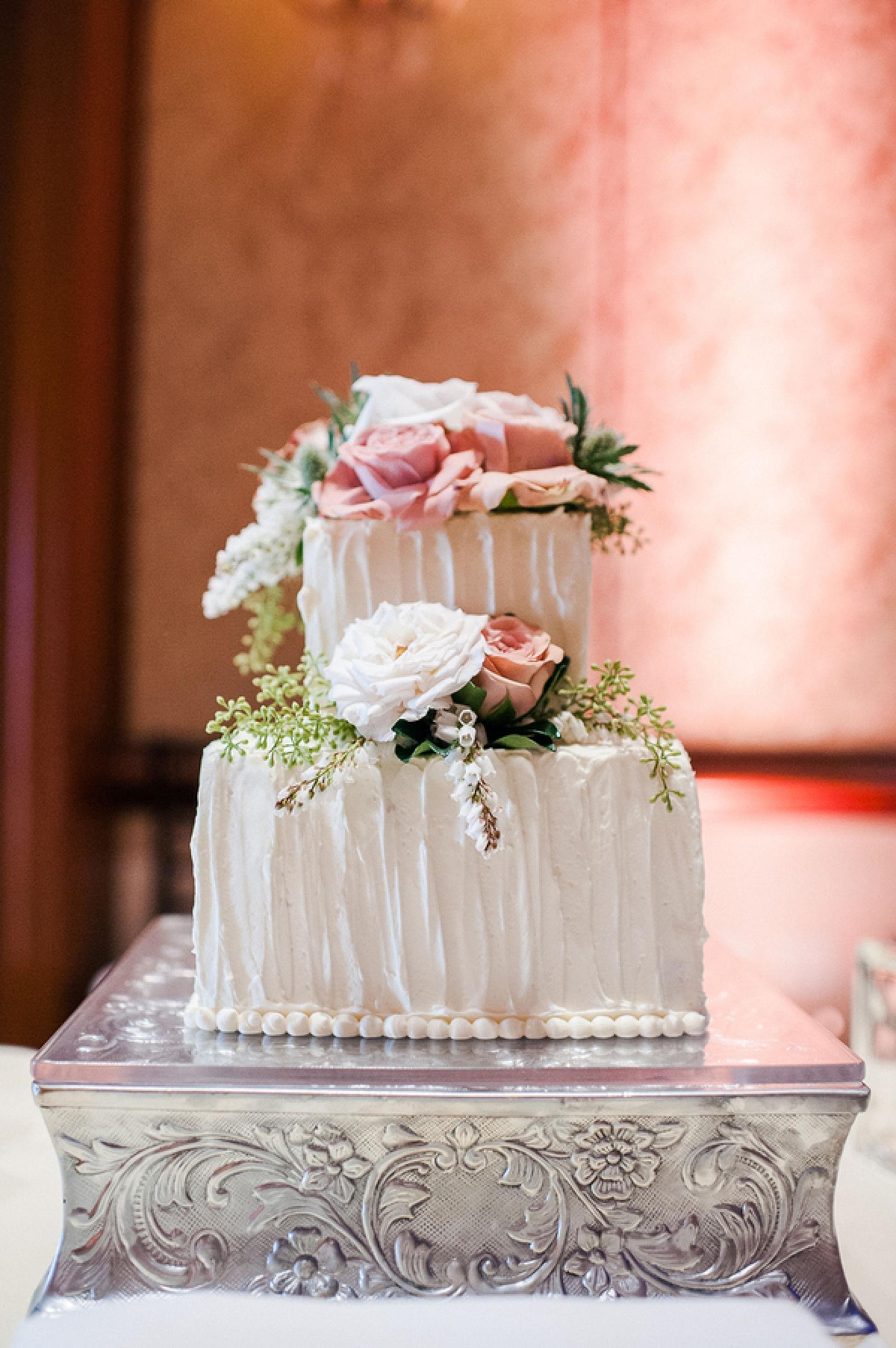 4 tier elegant pink wedding cake with white roses square