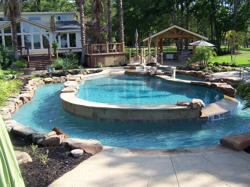 a pool and a lazy river custom inground pool built in the woodlands - Lagoon Swimming Pool Designs