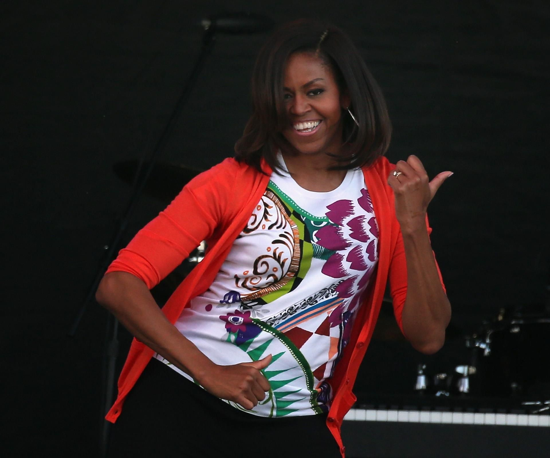 There's a new reason for Uptown Funk to be stuck in your head, as Michelle Obama made her on stage debut with the catchy tune and a whole heap of backup dancers on Monday.