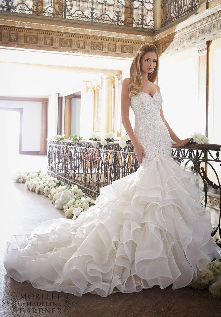 601bfed8cc5d ALENCON LACE MEETS FLOUNCED TULLE AND ORGANZAAvailable in Three Lengths: 55  , 58 , 61 . Colors Available: White, Ivory, Light Gold This gown cannot be  ...