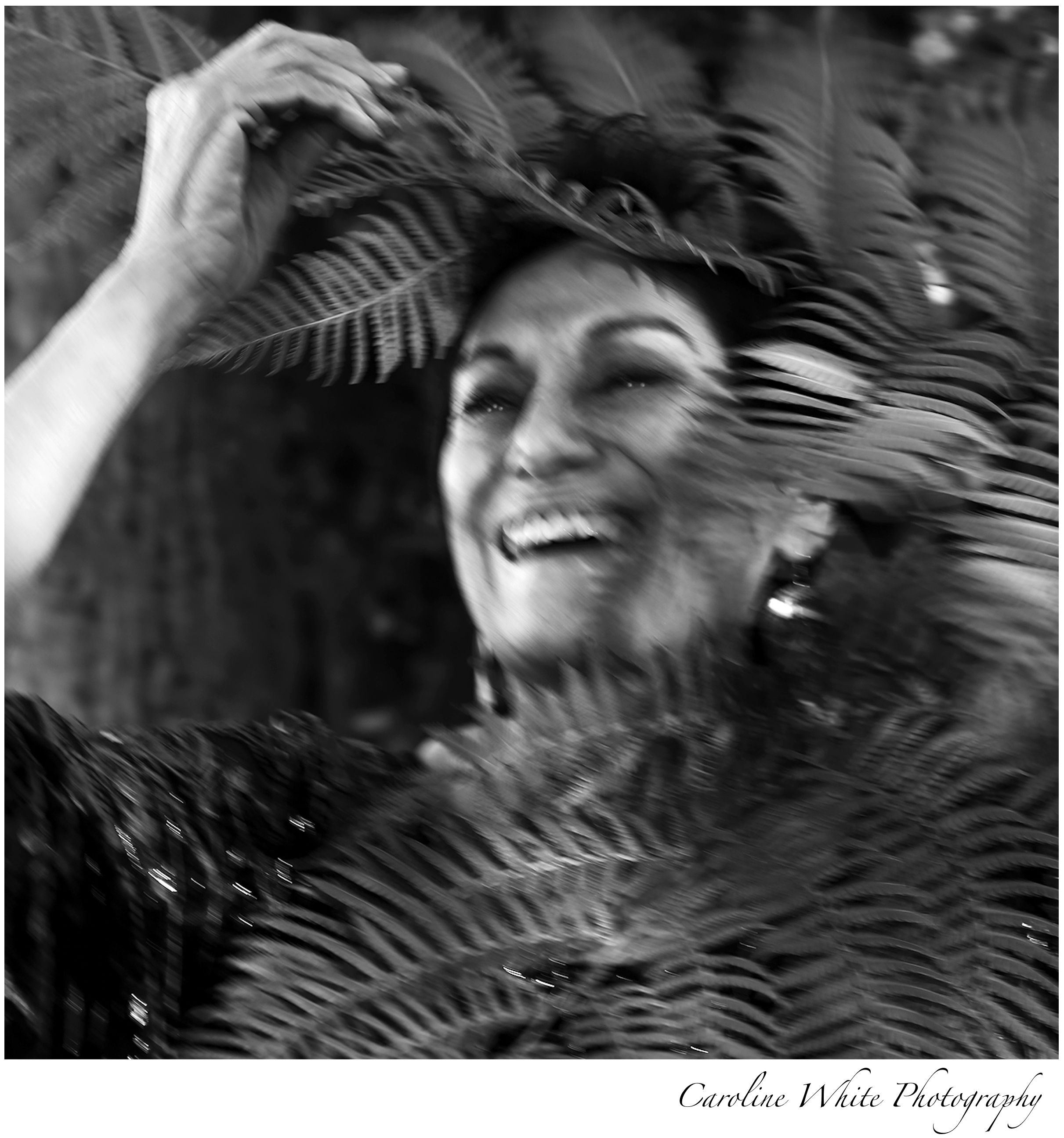 Nature meets luxury vogue vanity fair style women over 50 women over 60 iconic black and white creative photoshoot motion blur natural laughter