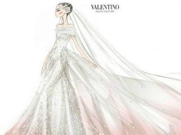 Valentino volvió a diseñar gracias a Anne Hathaway. El vestido es de seda y tul, repleto de cuentas de cristal con un marcado aire vintage y de princesa a la moda. No es totalmente blanco, en la parte inferior y de forma progresiva se distingue el rosa.