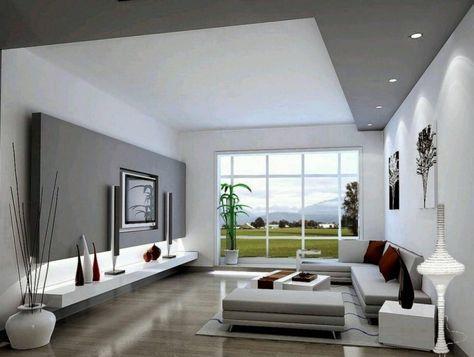 schlicht gehaltenes Wohnzimmer in Weiß und Grau TV Wand