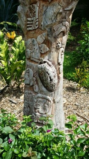 Sandos Caracol carved tree at the main entrance to the resort