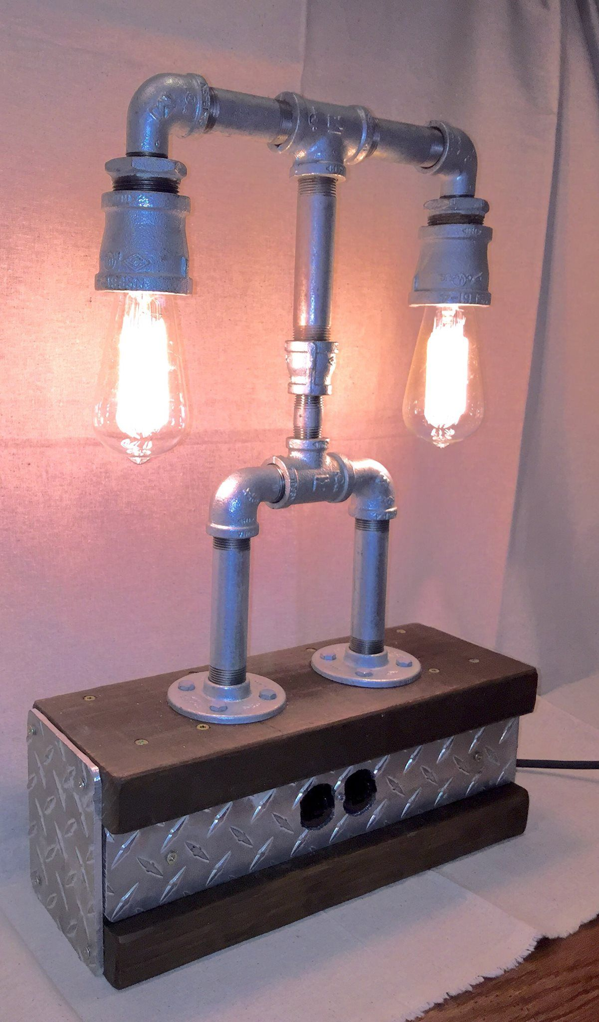 A Steampunk-inspired lamp built from galvanized plumbing parts, some ...