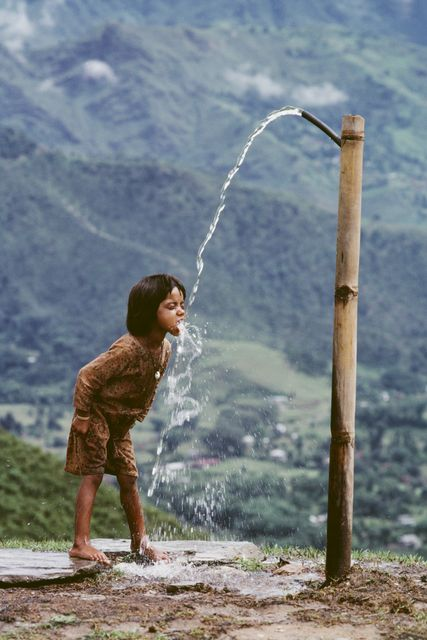 Steve McCurry | Child Drinks Water from Well, Nepal (1983) | Available for Sale | Artsy