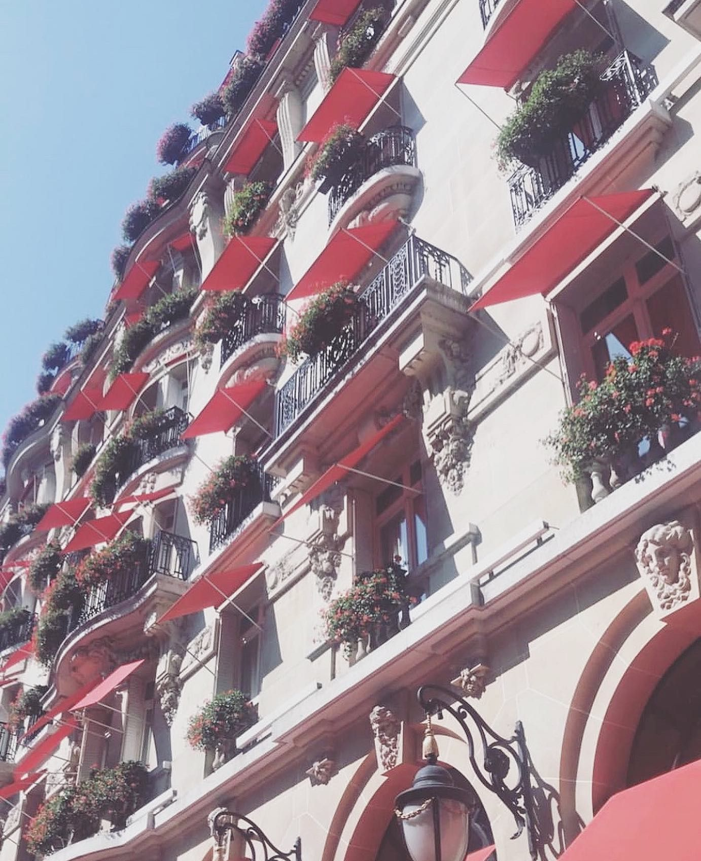 Paris May Be Known As The City Of Lights But Passion Radiates In This Dynamic City I Strolled By The Famous Histo In 2020 Hotel Facade Red Geraniums Plaza Athenee