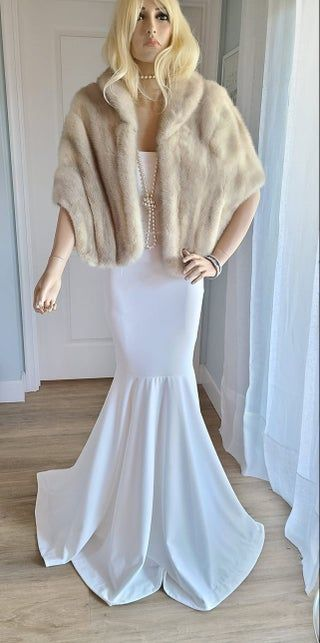 This elegant, luxury vintage mink stole, circa 1960's is truly stunning. A beautiful and graceful mid-century silhouette with classic sophistication. A one-of-a-kind heirloom fur perfect for a Fall or Winter bride to wear at her dream wedding.Details: A rich mix of hues, depending on lighting, this luxurious, vintage fur's natural color is a soft, creamy champagne blonde with smoky silver highlights. A neutral hue that would complement most ensembles. In the daylight, this luxury vintage fur ap