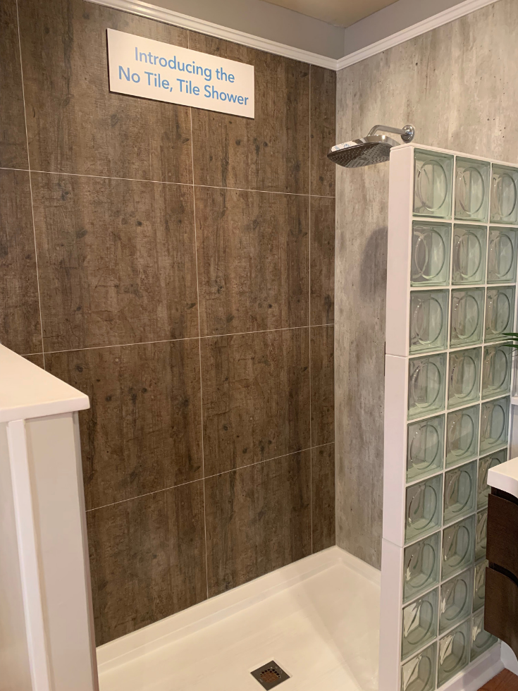 how to compare cultured marble vs laminated shower wall