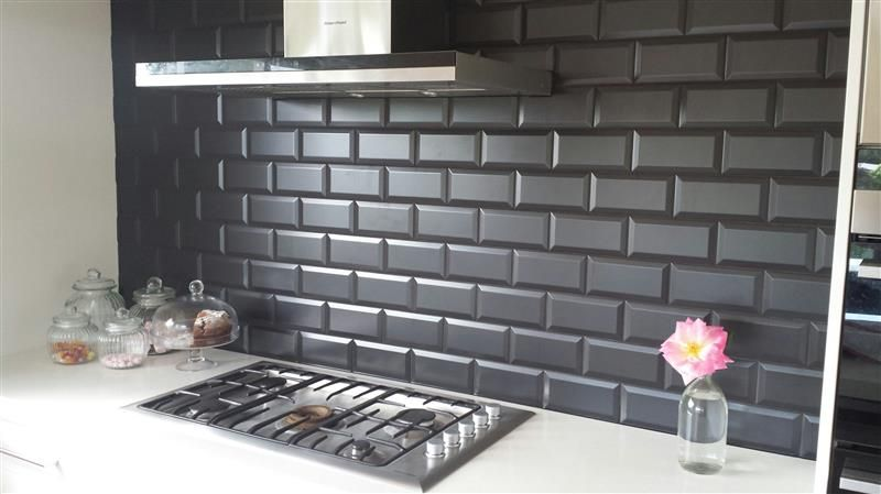 These Black Subway Tiles Look Amazing As A Kitchen Splashback And Contrasted Against The Black Wall Tiles Kitchen Backsplash Images Modern Kitchen Tiles Design