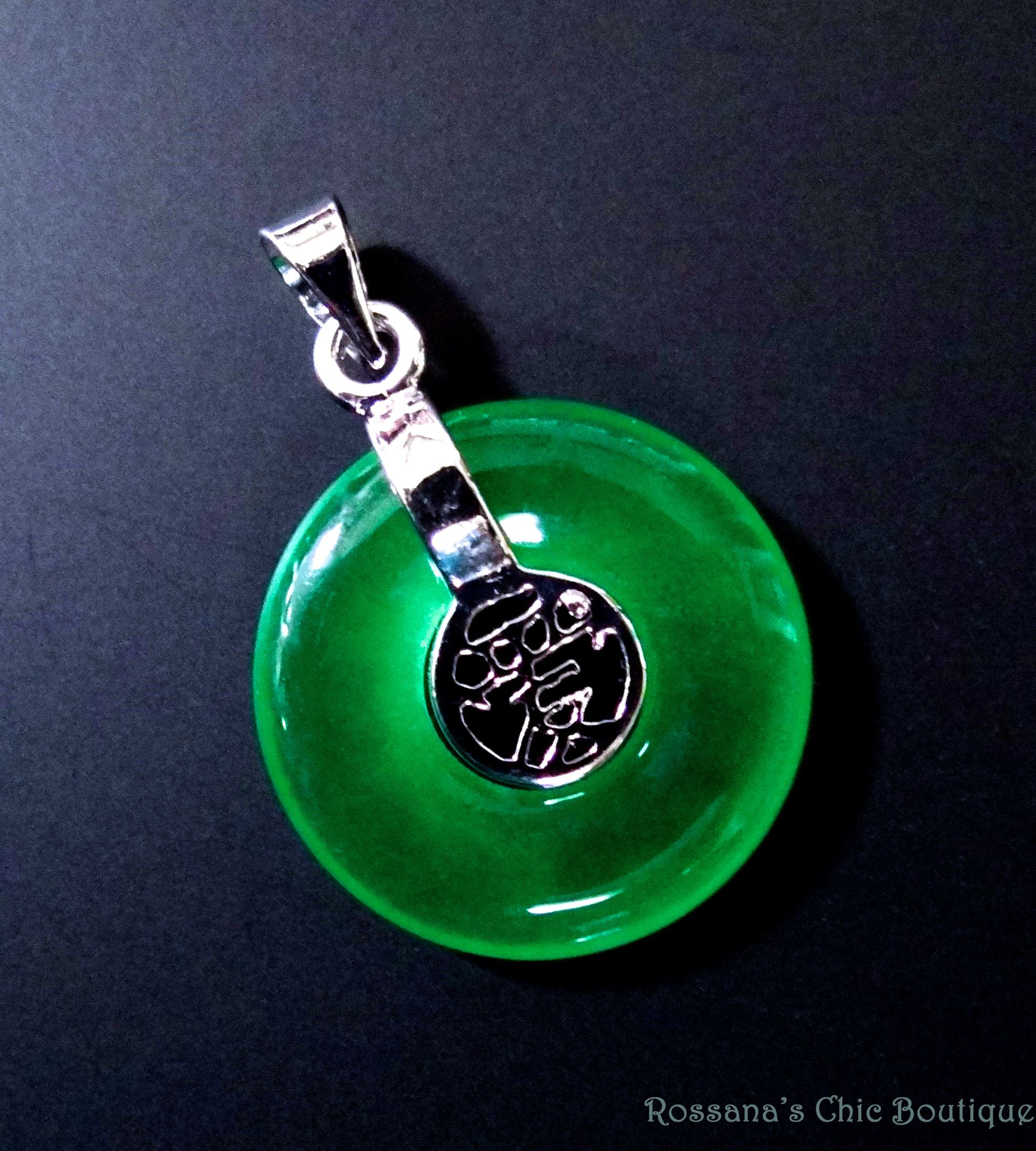 This Pendant Was Made Of Jade Carved In The Form Of A Ring With