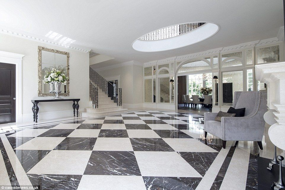 Mansion with cinema pool and 1 700 bottle cellar on sale for Dining room entrance designs