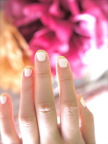 gold sparkly tips of nails!