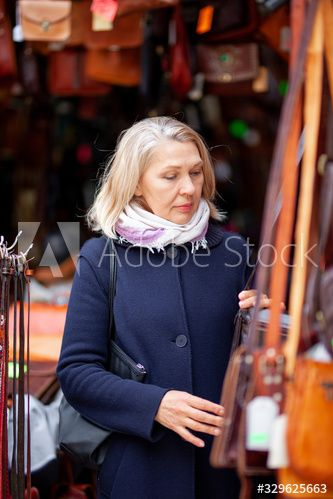 portrait of a woman in a leather bag shop #Ad , #Paid, #woman, #portrait, #leather, #shop, #bag
