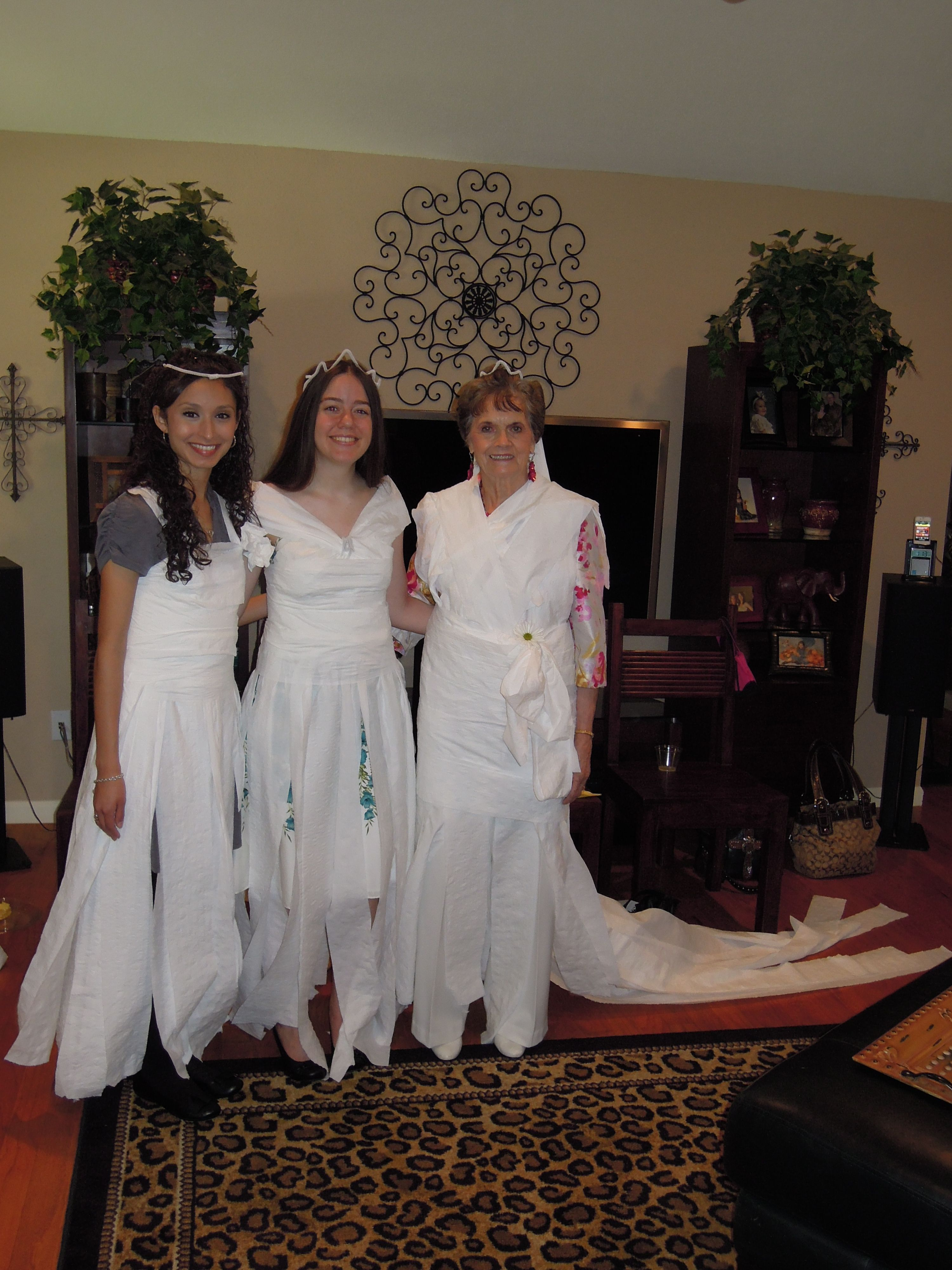 typical bridal shower game idea create a wedding gown with toilet paper team who creates best dress wins small prize