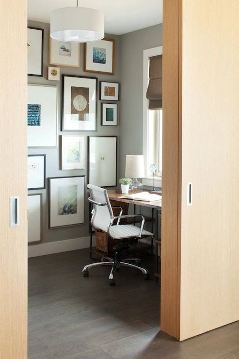 color art office interiors. gray walls paint color, art gallery, sawhorse desk, eames aluminum management chair, color office interiors n
