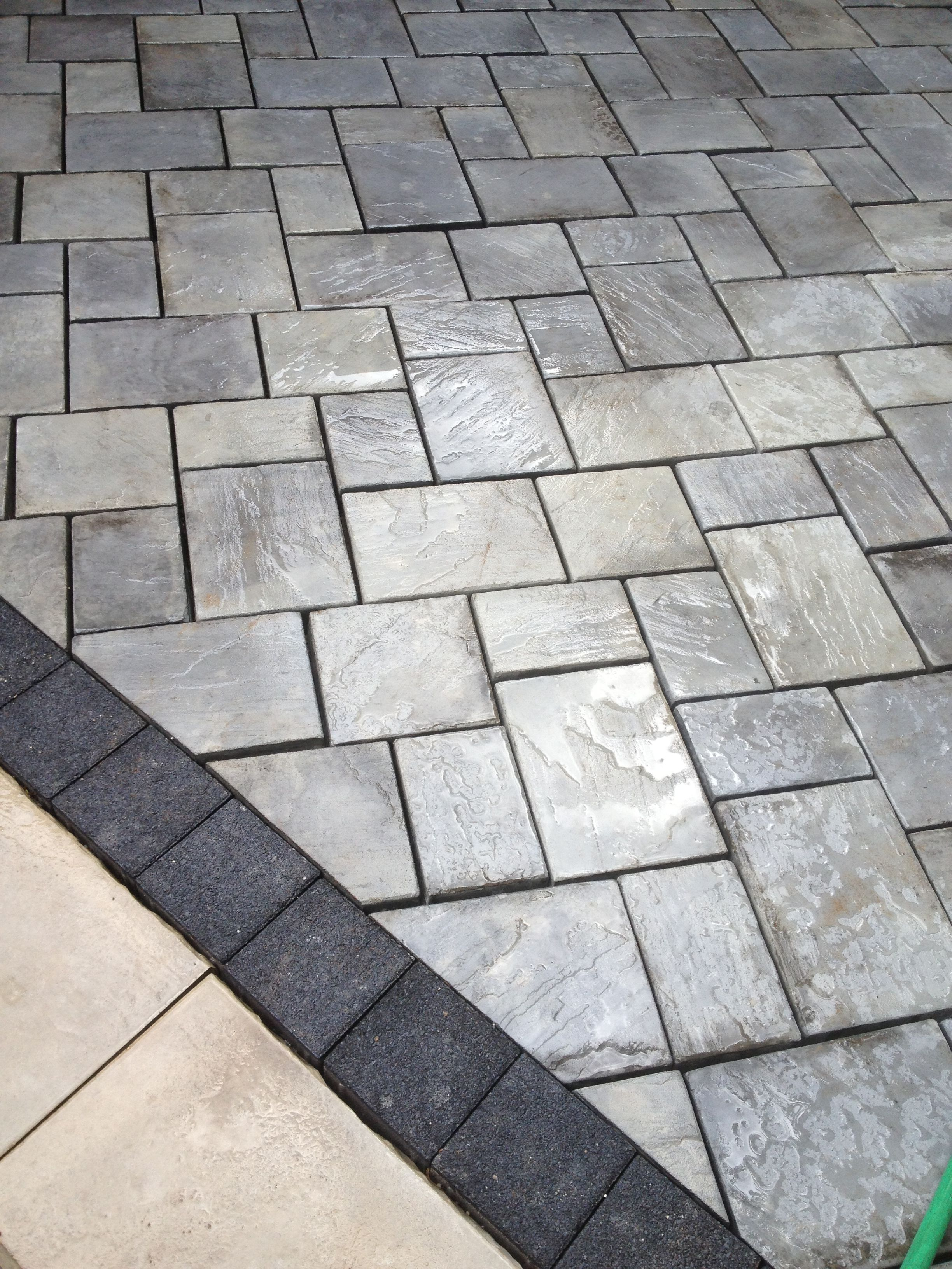 Beautiful Patio Using Unilock Brick Pavers. Stonehenge Coping, Series 3000  Black Accent Brick And