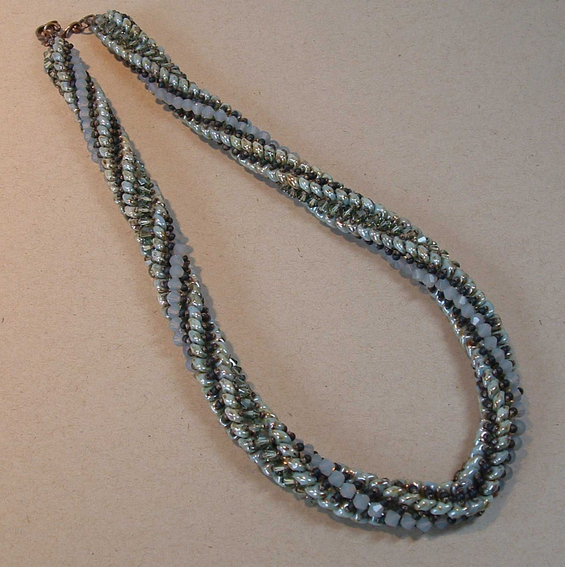 Crystals, seed beads, & duos create this gorgeous necklace – an original creation taught by author & designer Anna Elizabeth Draeger