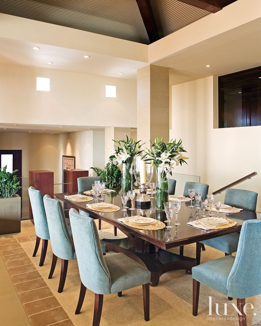 In The Elegant Dining Area, High Ceilings Are Complemented