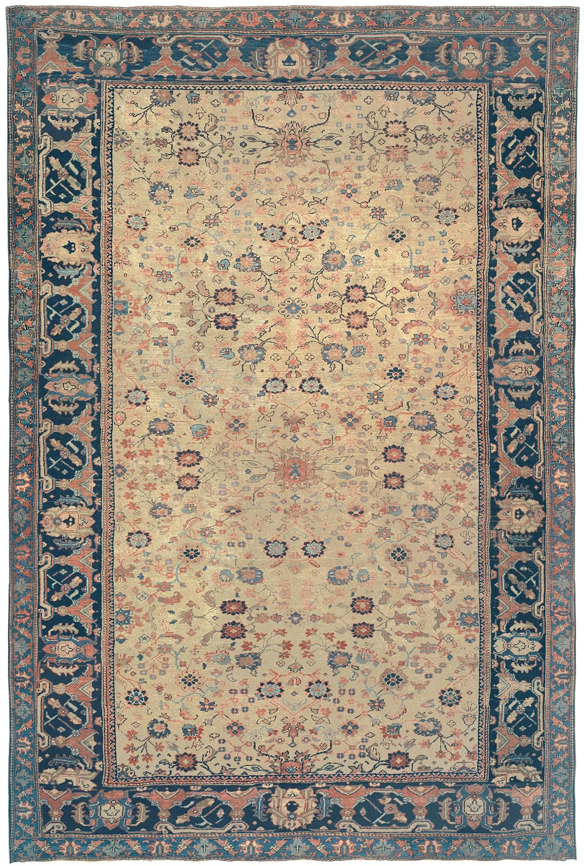 Sultanabad, 9ft 4in x 13ft 9in, 3rd Quarter, 19th Century. One of the most astonishing oriental carpets in the Hudson River Valley collection is this extraordinarily innovative antique Sultanabad. An artfully chosen, naturally dyed, golden wheat tone provides a glowing backdrop for its field populated by asymmetrically placed, continually changing blossom and vinery motifs. The traditional Persian border format is abandoned, as the two secondary borders bear no resemblance in design or size.