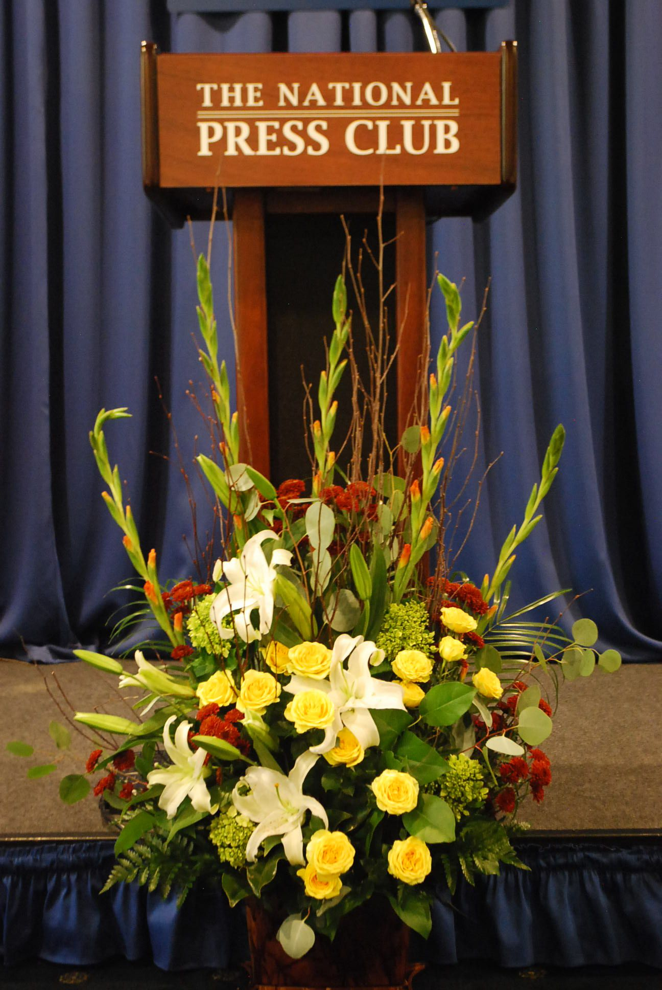 Fall color podium flower corporation for 7 events flower decorations