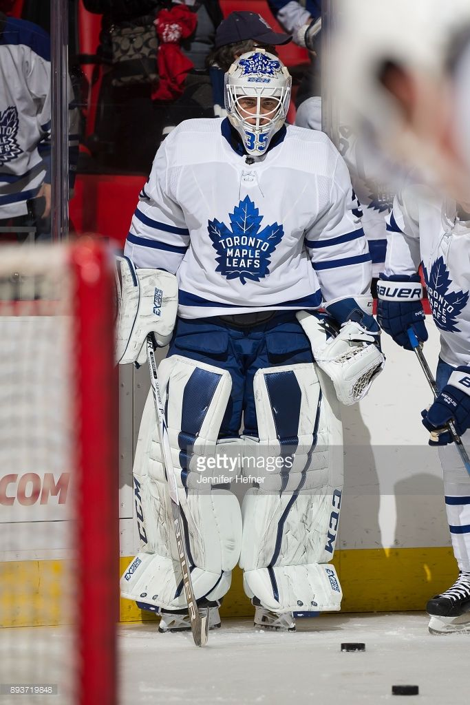 Goaltender Curtis McElhinney #35 of the Toronto Maple Leafs follows the play during warm-ups prior to an NHL game against the Detroit Red Wings at Little Caesars Arena on December 15, 2017 in Detroit, Michigan.