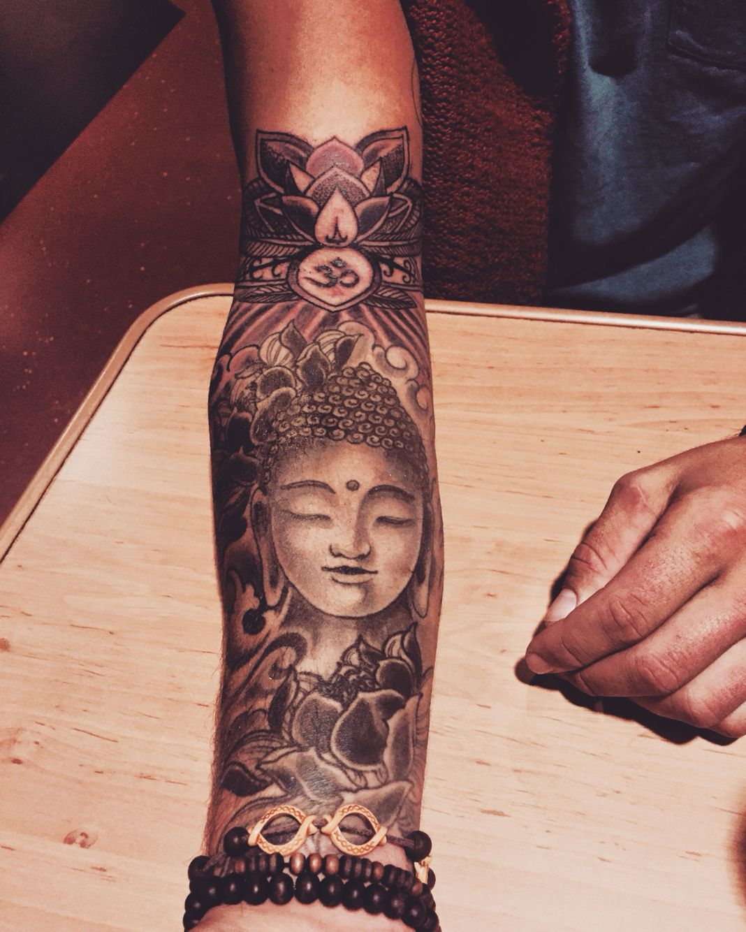 Budha tattoo with lotus lotus tattoo budha cool for Arm mural tattoos