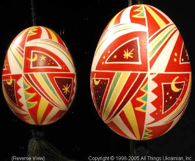 UA05163 (Stand Not Included). This Ukrainian Pysanky was created by the Artist: Iryna-Lviv. This Pysanka is made from a Chicken Egg as a Christmas Ornament.