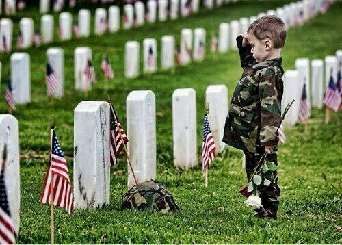 A young boy saluting his father at dad's grave (With images ...