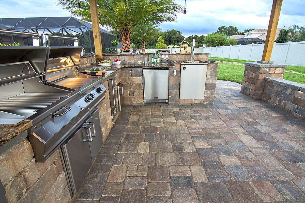 Create A Stunning Outdoor Kitchen With Stonegate Wall Blocks From Tremron Patio Plans Outdoor Kitchen Diy Outdoor Furniture