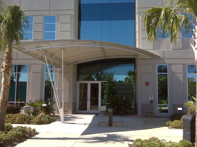 reduces provides benefits buildings commercial than dsc the are costs lower and seam longer maintenance awning a of protection some energy metal awnings fabric warranty sun elite for standing corrugated