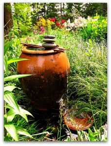 How to Make a Garden Fountain--interesting idea to make a fountain without spending a lot of money.