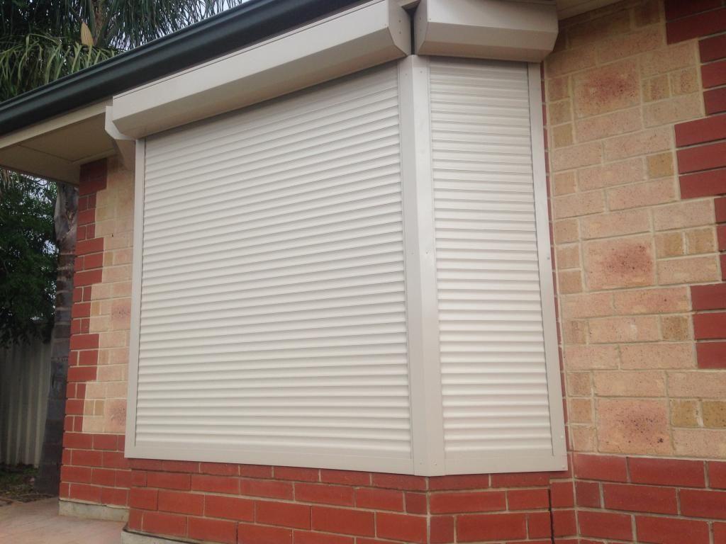 Window shutters bay window with motorised roller shutter window