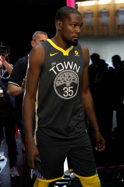 a365bf37788 Kevin Durant of the Golden State Warriors debuts the new jersey during the  unveiling of the New NBA Partnership with Nike on September 15 2017 in Los.