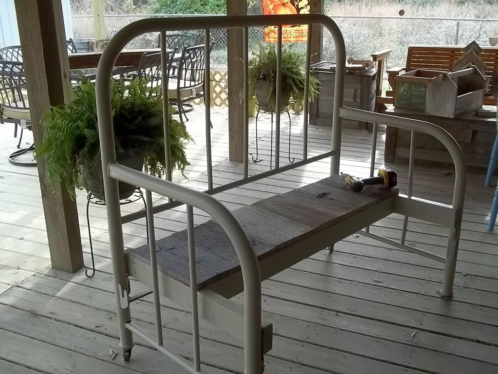 Garden bench out of antique bed. Use on porch or yard to